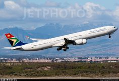 ZS-SNG and some winter snow on the Cape Town Mountains in the background.. ZS-SNG. Airbus A340-642. JetPhotos.com is the biggest database of aviation photographs with over 3 million screened photos online!