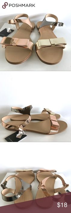 """🆕 NWT Zara Girls Metallic Tone Ribbon Sandals 🆕 NWT Zara Girls Metallic Tone Ribbon Sandals.  Zara girls size 38/US girls size 5.5 (per tag).  Please check your measurements against photo of Zara's size guide (in cm).  Shoes are purposefully """"mis-matched"""" (meaning the mixed use of metallic tones (rose gold, chrome/Silver and Gold) in a non-matching format is part of the design).  Brand new with tags.  Box not included. Zara Shoes Sandals & Flip Flops"""