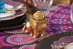 DIY Tip: Swap out the tealight in these gold elephant candle holders and make space for a sweet treat. These elephants make an adorable favor for guests to take home!