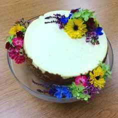 Wedding cheesecake decorated with wildflowers.