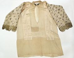 Wedding ensemble Date: late 19th century Culture: Albanian Medium: silk, cotton, metallic thread Dimensions: Length at CB (a): 45 3/4 in. (116.2 cm) Length at CB (b): 11 3/4 in. (29.8 cm) Length at CB (c): 32 3/4 in. (83.2 cm) Length at CB (d, e): 6 1/2 in. (16.5 cm) Overall (f): 34 1/2 x 34 1/2 in. (87.6 x 87.6 cm) Overall (g): 30 x 30 in. (76.2 x 76.2 cm) Credit Line: Gift of Burta May Taylor in memory of her husband, Elliot J. Taylor, 1988 Accession Number: 1988.362.1a–g