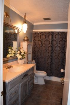 Grey milk paint cabinet, blue walls, slate floor - Master bathroom inspiration