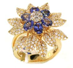 14k yellow gold flower ring features a center clustered with 2.42 cts. t.w. oval-shape tanzanite, with petals lined in 1.52 cts. t.w. diamonds that also gather at the center.