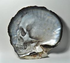 Skull hand carved on a mother of pearl shell