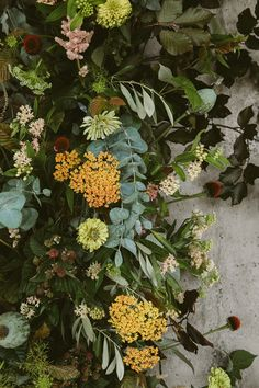 Urban Florals by Swallows & Damsons Raspberry foliage (underside) roses, aclepsia, dille, astilbe and scented tuberose in shades of gold, apricot and blush