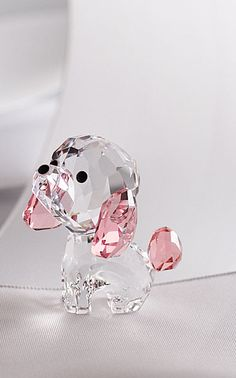 Swarovski Puppy - Rosie the Poodle - Representing peace and love, Puppy - Rosie The Poodle will put a smile on your face. She is crafted in a sparkling mix of clear and pink crystal, creating an eye-catching effect. A great gift for dog owners! Gifts For Dog Owners, Dog Gifts, Swarovski Crystal Figurines, Swarovski Crystals, Tea Cup Poodle, Accessoires Iphone, Glass Figurines, Cute Jewelry, Geek Jewelry