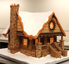 Cool Gingerbread cabin details: stone work, front porch stairs, gable, roof line Gingerbread House Designs, Gingerbread House Parties, Gingerbread Village, Christmas Gingerbread House, Christmas Treats, Christmas Baking, Gingerbread Cookies, Italian Christmas, Gingerbread House Decorating Ideas