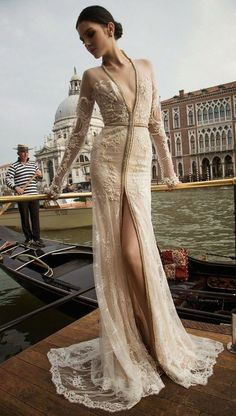 Gold kimono wedding dress: The shape of this dress resembles that of a robe, the exact piece of clothing that you pull out of your closet on a chilly fall morning. Embrace this association and take it to the next level with an incredible, embellished wedding dress that you'll never want to take off.