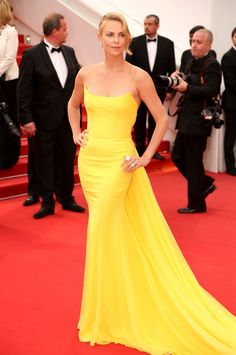 Charlize Theron Dazzles In Yellow At Cannes, 2015