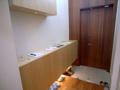 This is a genkan (where you take your shoes off when you enter a Japanese home).  We don't have shoes on in our house, and something like this would make it a lot easier.