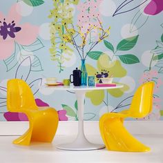 If the wallpaper was fabric curtains...and the chairs are a little too modern, but I love the bold color