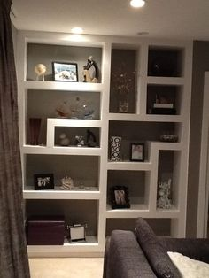I love these uneven shelves.   From: https://s-media-cache-ak0.pinimg.com/736x/3b/c1/1c/3bc11c4326e6d1c0c06641ad161294ba.jpg