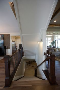 pillars and open staircase to basement google search - Living Room Design With Stairs