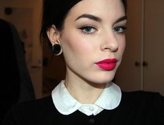 A classic look, with a modern twist by paring it with fuchsia lipstick. Love it!