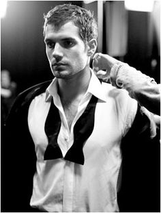 Something about Henry Cavill with an undone tuxedo tie. He looks so ruggedly handsome. Mr. Bond anyone?