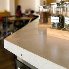 Countertop - Squak Mountain Stone    An alternative to quarried stone, slabs are made of fly ash, post-industrial crushed glass, and low-carbon cement.    Cost $50/sq. ft.    Eco-friendliness 50% recycled content including paper; 1/3 less CO2 produced during manufacturing.