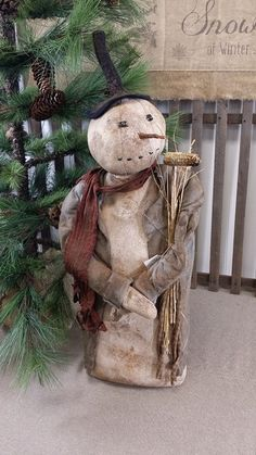 Primitive Snowman with a Corn Cob Pipe Primitive Christmas Patterns, Primitive Country Christmas, Primitive Snowmen, Primitive Crafts, Christmas Snowman, Winter Christmas, Primitive Stitchery, Wooden Snowmen, Primitive Patterns