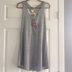 Cute dress Lily Bleu Beach swim coverup, size large.  Sequined flamingo on front, grey.  Soft fabric, 85% polyester, 32% rayon, 3% spandex.  Great swim coverup or can be used as a dress!  New with tag attached. Lily Bleu Beach Swim Coverups