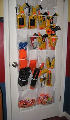 So many nerf guns--so little time! So here are loads of fun ideas on nerf gun storage so you can get them off the floor and organized! Nerf Birthday Party, Nerf Party, Creative Toy Storage, Storage Ideas, Easy Storage, Pistola Nerf, Nerf Gun Storage, Airsoft Storage, Shoe Storage
