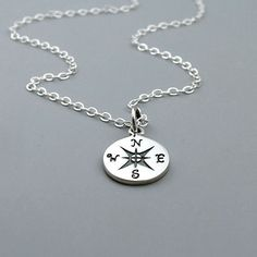 This necklace features a beautiful solid sterling silver compass charm on a shimmering sterling silver chain. This would make a lovely gift for