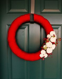 yarn wrapped wreath ... beautiful red with white rolled felt flowers ...