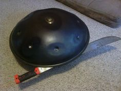 Cutting open a Saraz handpan. We find a sledge hammer hitting the back of a machete does the best job after hammering a small knife in between shells in order to open up an area to get the machete in. Correctly cured glue is incredibly strong!