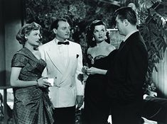 Robert Mitchum, Jane Russell, Marjorie Reynolds, and Philip Van Zandt in His Kind of Woman (1951)