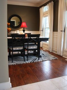 Laminate flooring from Sam's Club!  Select Surfaces in Canyon Oak in stair-step design.