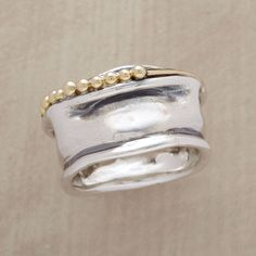 "MUSEO RING -- Sculpture to wear, the wavy convolutions of hand cast sterling silver are overlaid with a beaded ribbon of 14kt gold. A Sundance exclusive in whole sizes 5 to 9. 1/2""W."