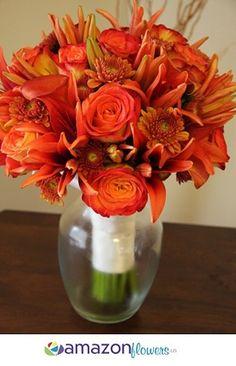 bi color orange and yellow roses, orange lilies, purple poms, burgandy calla lillies :)