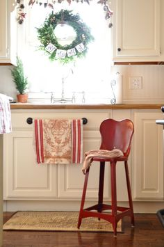 white kitchen with red for highlights.