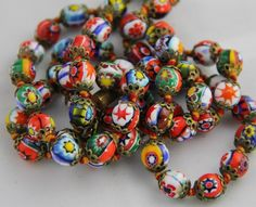 Early to Mid 1900's hand strung MURANO art glass necklace. Artisan crafted MULTI-COLOR MILLEFIORI beads with red and gold double strand thread. The beads are @ $195