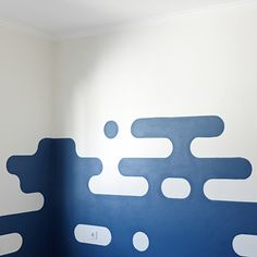 a simple space / cloud theme mural inspiration for kids room. an easy alternative to mountains and hills murals.