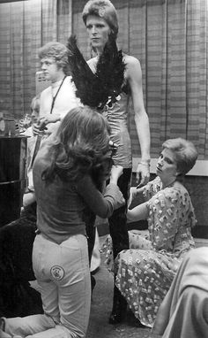 Angie Bowie and Suzi Fussey helping David with his costume, 1973.