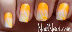 Frostbitten Orange Nails