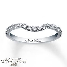 Round diamonds grace this exceptional wedding band for her from the Neil Lane Bridal® collection. The 14K white gold band is contoured to fit her matching engagement ring. The band has a total diamond weight of 3/8 carat. Diamond Total Carat Weight may range from .37 - .44 carats.