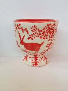 Hand painted ceramic egg cup with red animal pattern by TabbyBooth, £10.00