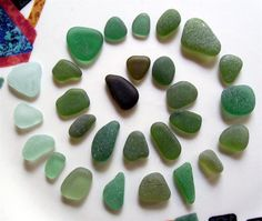 Although green glass colors (from beer bottles or wine bottles), along  with brown and white, make up the most commonly found colors of beach  glass, there are also lighter or darker greens and hues of green that  are far less common... Read more: http://www.odysseyseaglass.com/green-sea-glass.html