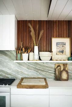 shiplap walls, modern cabinets and statement marble backsplash make for a stunning update tot his midcentury kitchen | house tour coco kelley