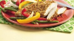 Paired with colorful peppers and beans, crispy cereal-coated chicken makes an appealing meal for six, complete in less than an hour.