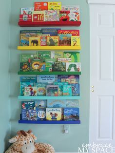 DIY Rainbow Book Ledges for Children's Books and see how they are color coordinated with the books!!