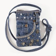 The Best Upcycled Denim Crafts & DIY Why not recycle your old jeans into somethi. The Best Upcycled Denim Crafts & DIY Why not recycle your old jeans into somethi. Diy Jeans, Denim Bags From Jeans, Diy Denim Purse, Sacs Tote Bags, Diy Sac, Denim Ideas, Embellished Jeans, Handmade Bags, Purses And Bags