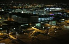 Aircraft park up in their stations, pictured from the control tower is Terminal 3, and in the distance, Terminal 2 with its distinctive wave roof