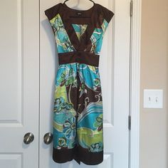Dress Knee length dress with cap sleeves. Great condition. Barely worn. Silky material. BCX Dresses