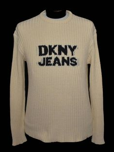 Vintage 90s ribbed knit sweater by Donna Karan. Features DKNY Jeans spelled out on a medium weight ribbed crew neck sweater. DESIGNER: DKNY Jeans The Official Uniform of New York 100% Cotton Made in USA  SIZING: Size tag is unreadable. Based on the measurements below, this would