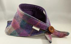 Part of The Country Collection range by pinkfluffykitty  A luxury bandana made from Authentic Lilac Harris Tweed and lined with purple cotton linen  With a velcro fastening and decorative button  Fits up to approx. 17 neck size. For Medium sized dogs (Eg - Greyhound)  UK orders will be posted via Royal Mail First Class Signed For International orders for bandanas will be shipped via Royal Mail Signed and Tracked