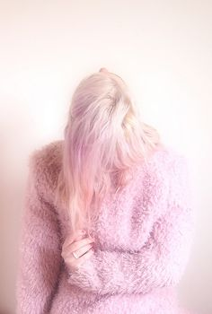 Since I plan to dye my hair pink this weekend, I kind of want this sweater now.