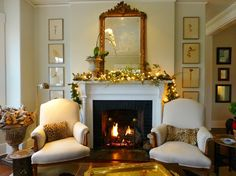 Pictures on wall by fireplace; 3 mirrors hung in column.  From blog: for the love of a house