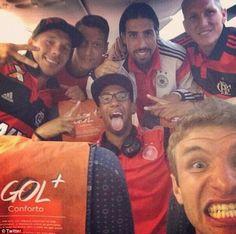 All smiles: Germany stars Lukas Podolski, Mesut Ozil, Sami Khedira, Bastian Schweinsteiger...