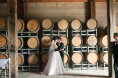 Hunter Valley Wedding Photography Wandin Valley Bride & Groom Kiss Barrels. www.somethingbluephotography.com.au
